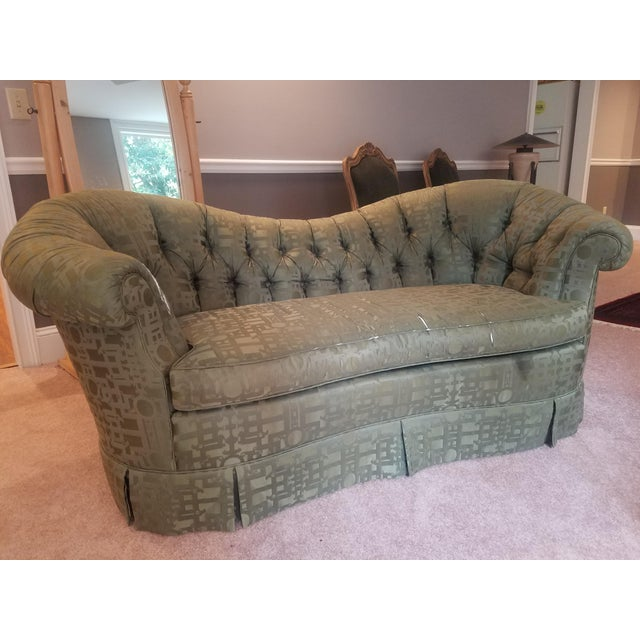 Purchased from Baker Furniture. Classic design with a curved and swayed back. Scrolled arms over a shaped bench cushion...
