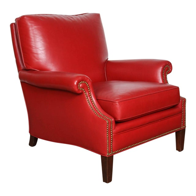 Pair of club leather lounge chairs in a deep Moroccan red leather, very comfortable. Brass nailhead studded in front and...
