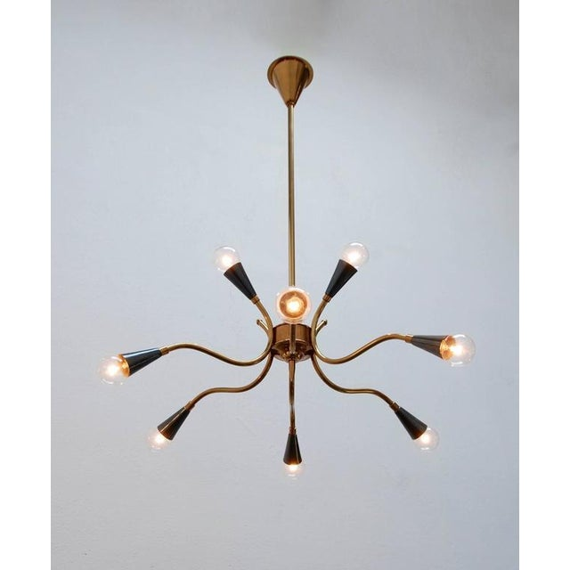 Solid brass Italian Sputnik with nine lights. Candelabra based sockets. Beautifully restored, and rewired for use in the...