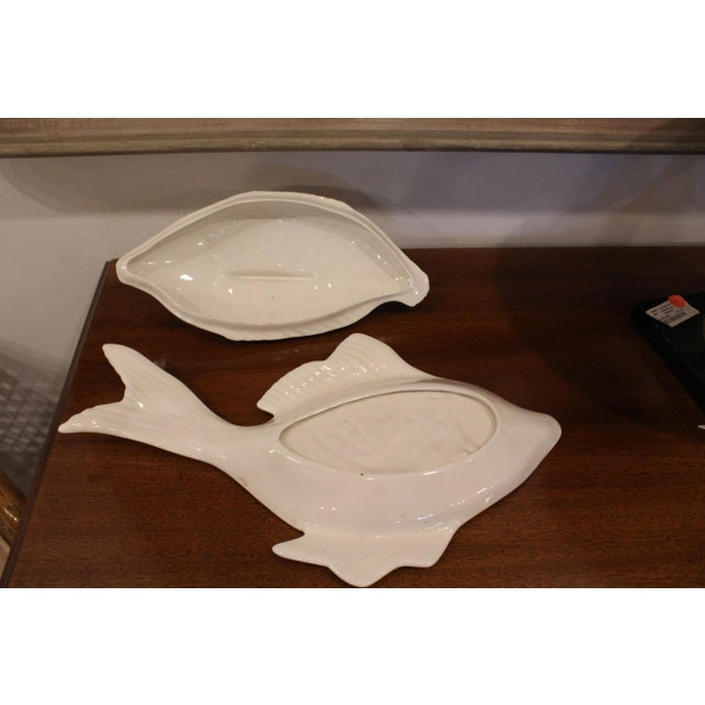 Covered pottery glazed white fish platter and dish marked Joe, 68.