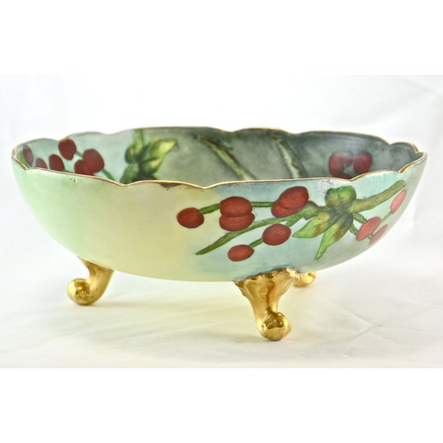 Large antique hand-painted artist signed French Limoges porcelain footed bowl with a vibrant still life of cherries in...