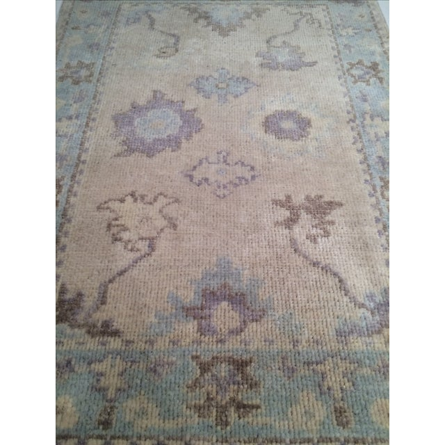 Hand knotted Oushak rug. Hand-spun lamb's wool rug with all natural dyes. From India.