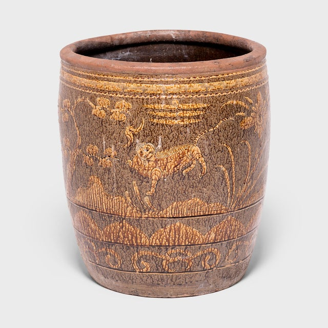 This early 20th-century jar was hand-sculpted in southern China and decorated with lion dogs and pine trees, symbols of...