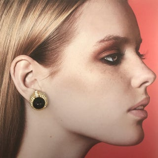 Clip on Earrings With Black Acrylic Center and Gold Tone Round Based Preview
