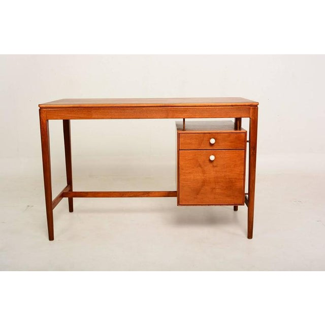 AMBIANIC is pleased to offer for your consideration a Mid century desk in Walnut wood by Drexel designed by Kipp Stewart...