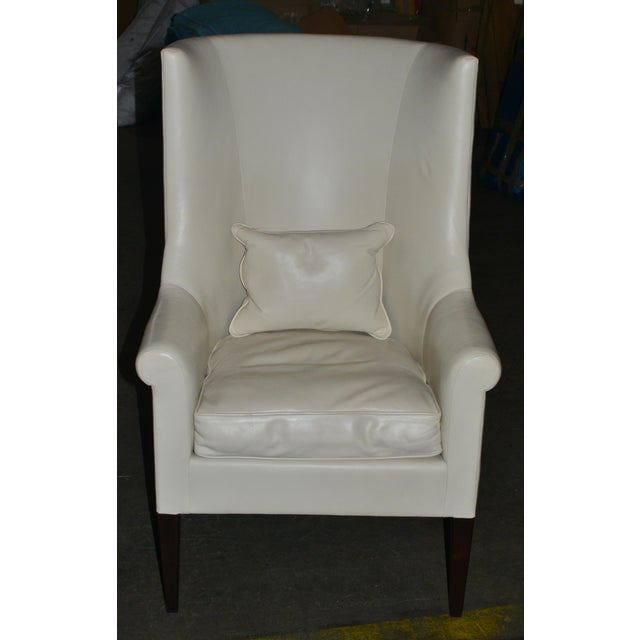 Modern pair of high back armchairs upholstered in white leather, with a pair of leather cushions, made by Dessin Fournir....
