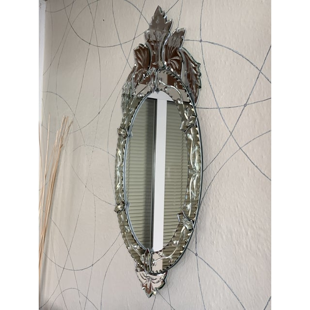 About Venetian glass mirror with shaped and engraved border mirror glass surmounted by engraved mirrored naturalistic...