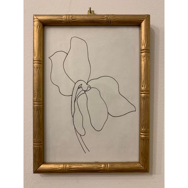 This sweet ink drawing is framed in a vintage gold frame with bamboo carving. Perfect for a bookshelf or side table. Wired...