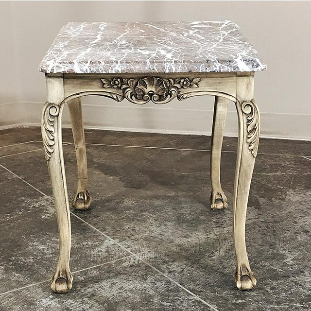 Antique Regence Marble Top Stripped Walnut Occasional Table boasts a framework sculpted from fine French walnut in the...