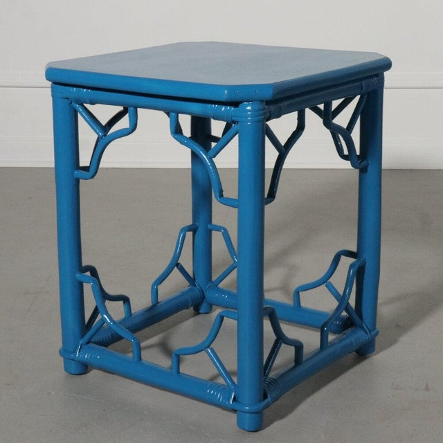 Wood side table with rattan fretwork. Hand painted in a glossy modern blue.