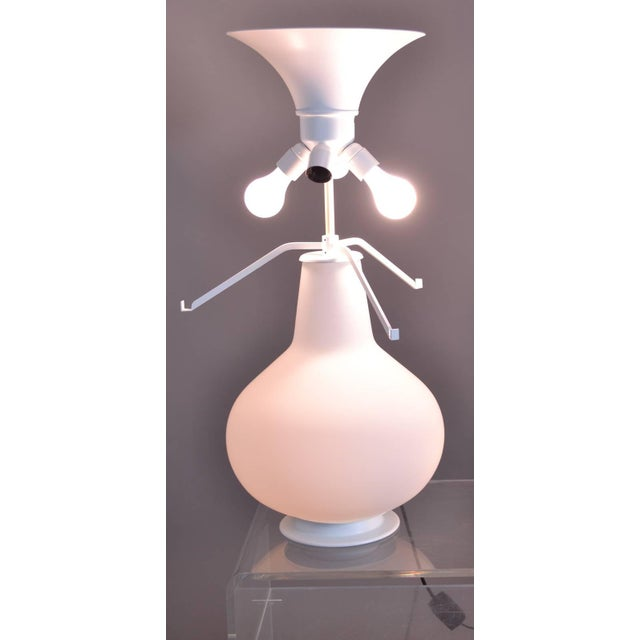 Designed by Max Ingrand in 1954, these lamps come in three sizes --we have the large versions here. Frosted glass base and...