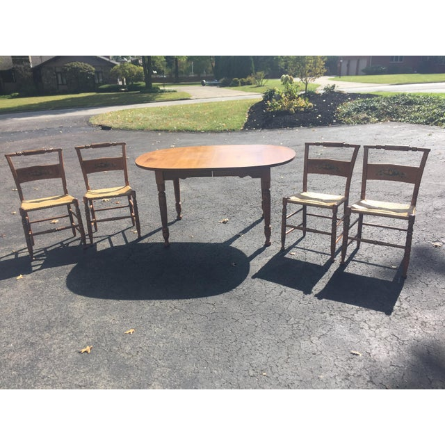Mid-century Modern (1968) authentic Heywood-Wakefield table with three leaves and four chairs exudes warmth and...
