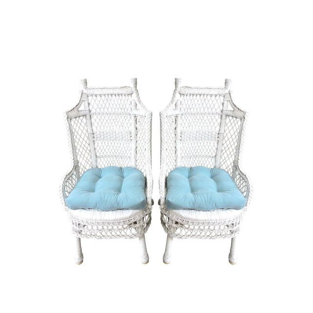 A pair of handsome white wicker and cane conservatory armchairs made in the middle of the 20th. Century. Generously...
