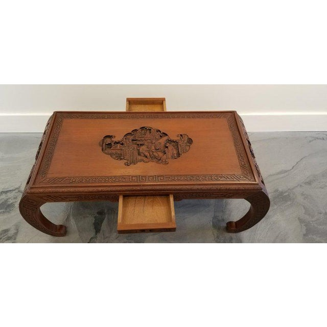 Hand-carved Chinese Ming style coffee table, circa 1950s-1960s. Nice detail to carved figures and Asian architecture with...