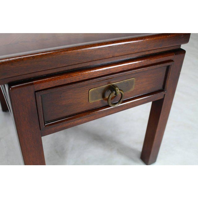 Mid-Century Modern double pedestal flame mahogany coffee table with two drawers.