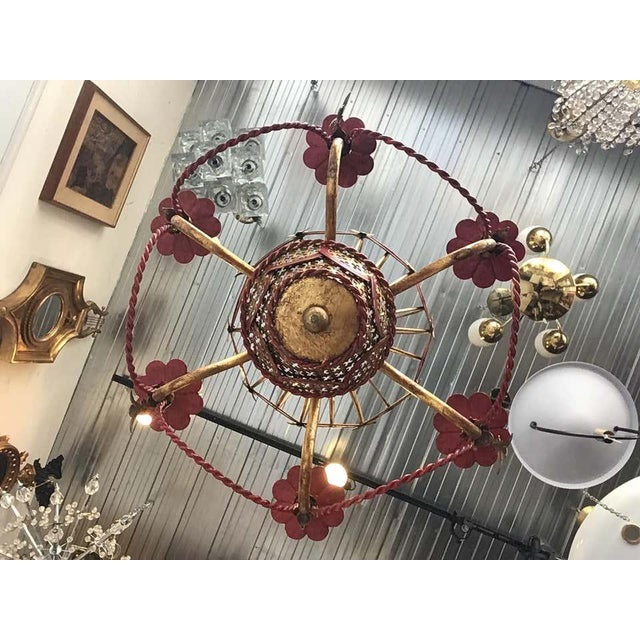1970s Italian gilt iron hot air balloon chandelier. Decorative ornament hangs on every other arm.
