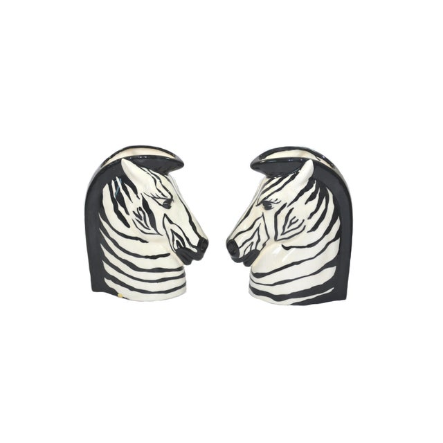 This is a beautiful pair of Zebra head vases by Banyan of Florida. Very rare pair of Zebra head vases in an Art Deco style...