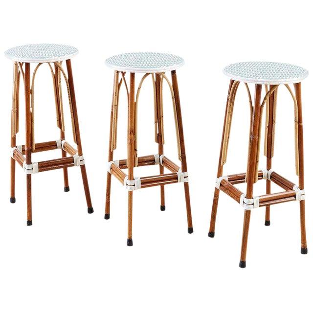 Set of Three Maison Gatti Rattan French Bistro Barstools For Sale