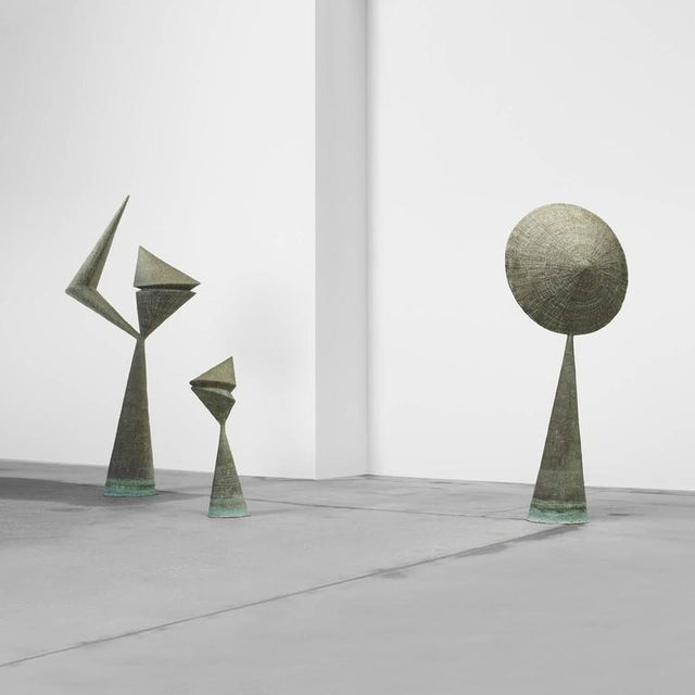 This important grouping of bertoia sculptures were the centerpiece of the stemmons towers international sculpture garden...
