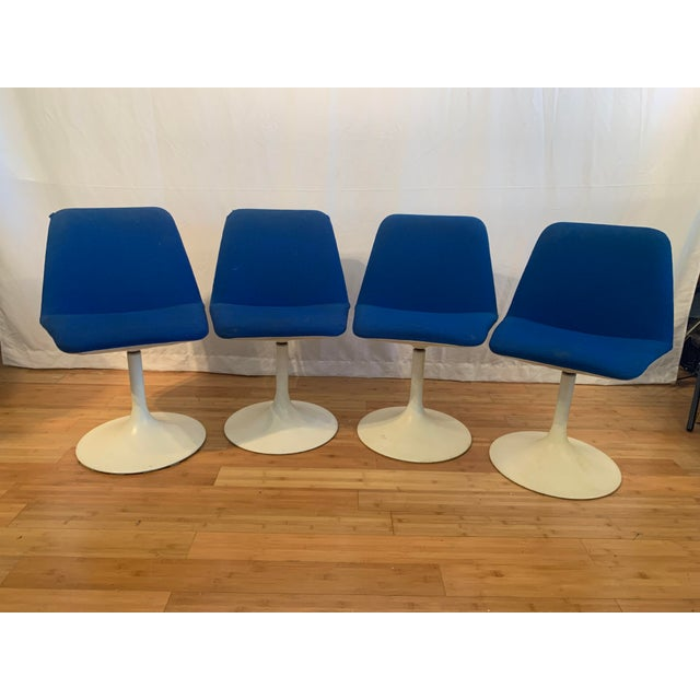Set of 4 blue modern swivel chairs with white tulip bases designed by Borje Johanson.
