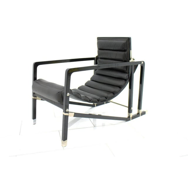 Black leather lounge chair by Eileen Gray Transat by Ecart International, 1980s. Black lacquered wood, brushed metal,...