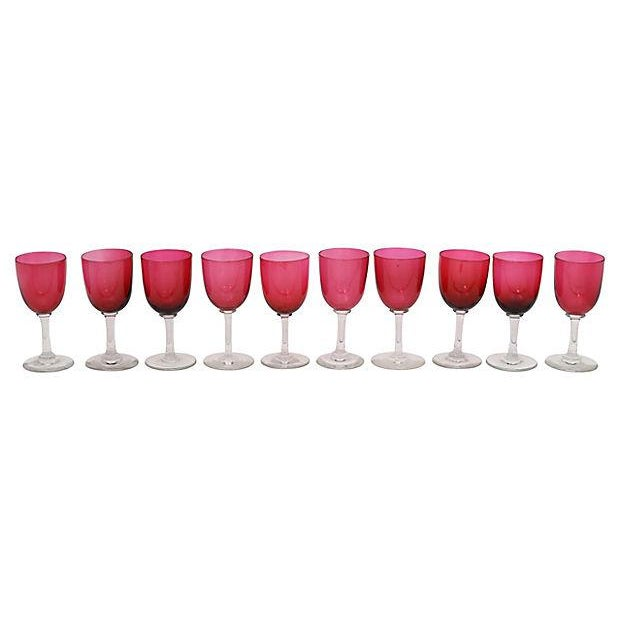 Set of ten hand-blown English cranberry stems. No maker's mark. Light wear. Due to the nature in which they are made,...