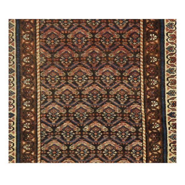 This beautiful rug is handmade, 100% wool pile, made in Iran. It features a pattern in a vibrant combination of red,...