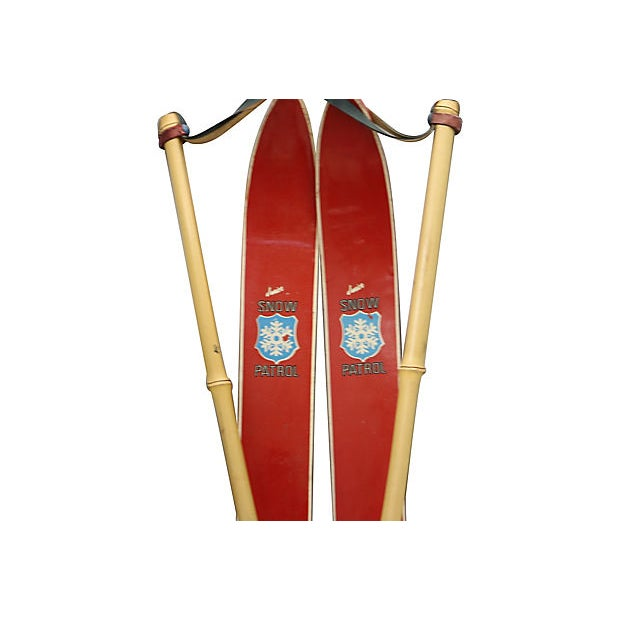 "Mid-Century children's skis with poles. For decorative use only. Poles, 3.75""Dia x 29.5""L; skis, 28.5""L x 2.5""W x 3""H...."