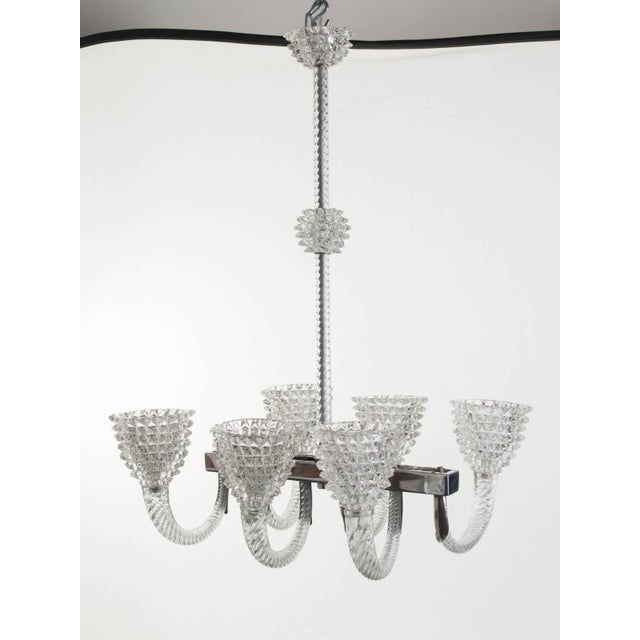 Vintage handblown clear glass [rostrato] oblong-shaped chandelier comprised of six lights. Ornate silver fittings and...