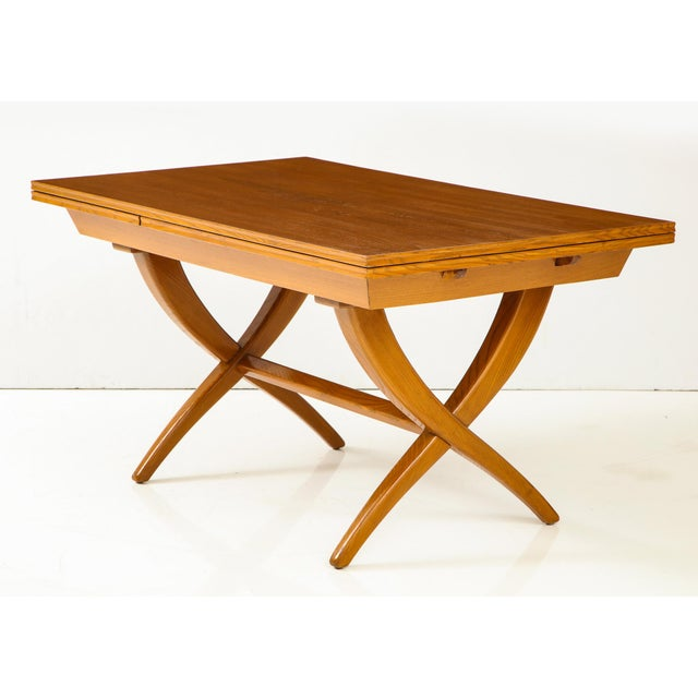 Handcrafted extension table of boldly grained oak with chamfered edges and inset leaves by Florentine artisan and designer...