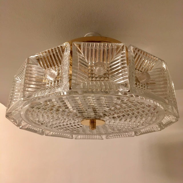 An original thick heavy chunky crystal flush pendant or hanging chandelier with golden brass fittings made by the famed...
