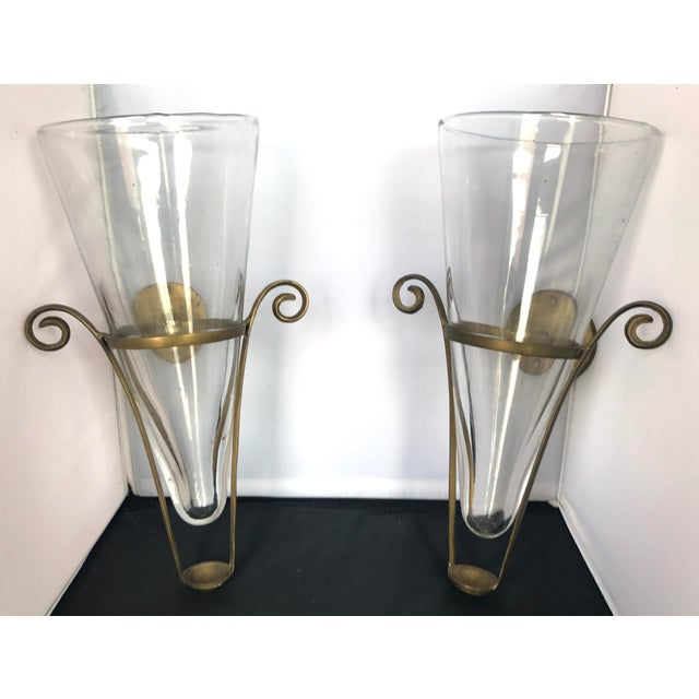 Beautiful pair of Blown Glass Vases/Sconces with Brass Brackets. This pair will open up plenty of decorating possibilities...