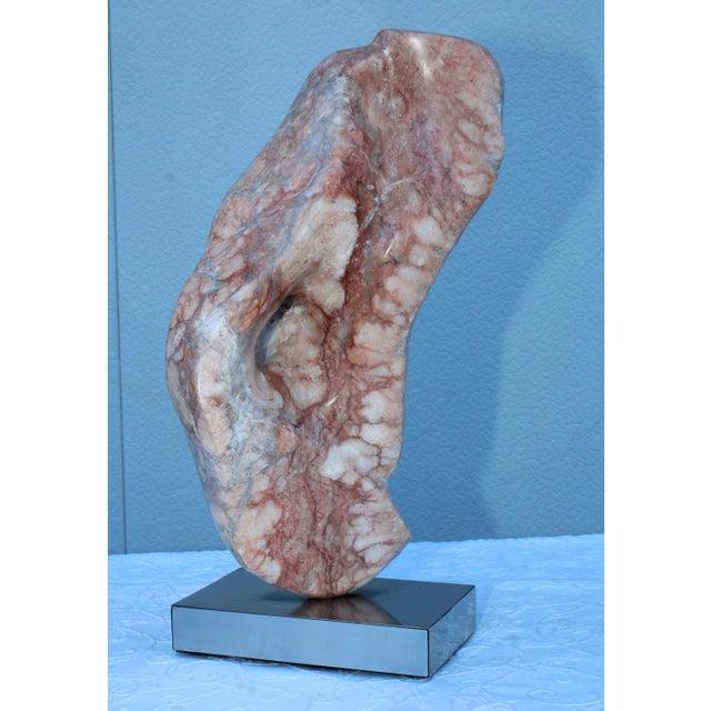 Stunning 1970s Mid-Century Modern abstract marble sculpture on swivel base.