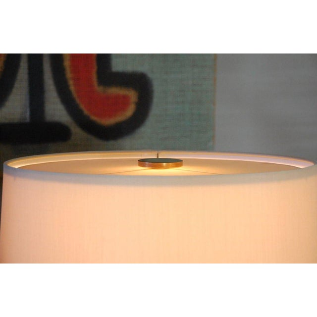 Sculptural cypress root table lamp with custom silk shade.