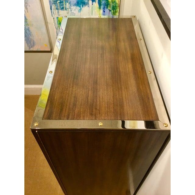 Stylish modern Henredon Bihuber Barclays St. bar cabinet finished in an opulent mahogany, octagonal faux tigers eye...