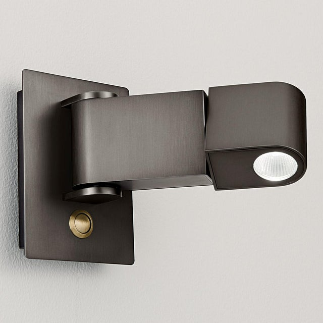 Black bronze with English brass LED wall reading light with a colour coordinated push button switch. The driver is in the...