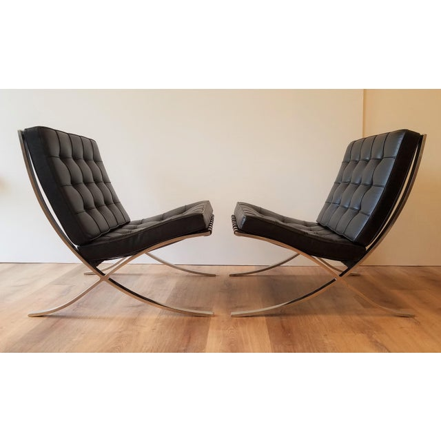 Vintage 1970 Barcelona Chairs for Knoll with their original black leather upholstery. Designed by Ludwig Meis van der Rhoe...
