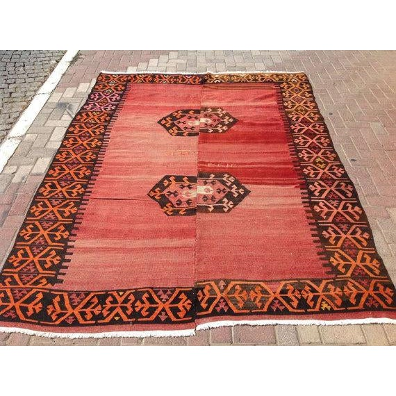This beautiful, vintage, handwoven kilim is approximately 70 years old. It is handmade, of very fine quality in all...