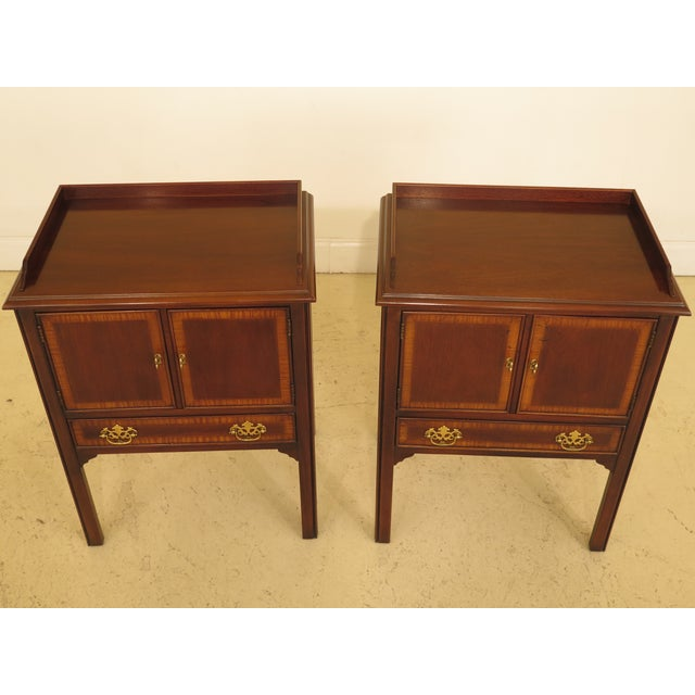 This is a pair of vintage Drexel nightstands or commodes that are about 20 years old. The pieces are made of mahogany....