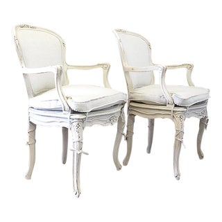 Early 20th Century Vintage Louis XV Style Carved and Painted Open Arm Chairs - A Pair For Sale