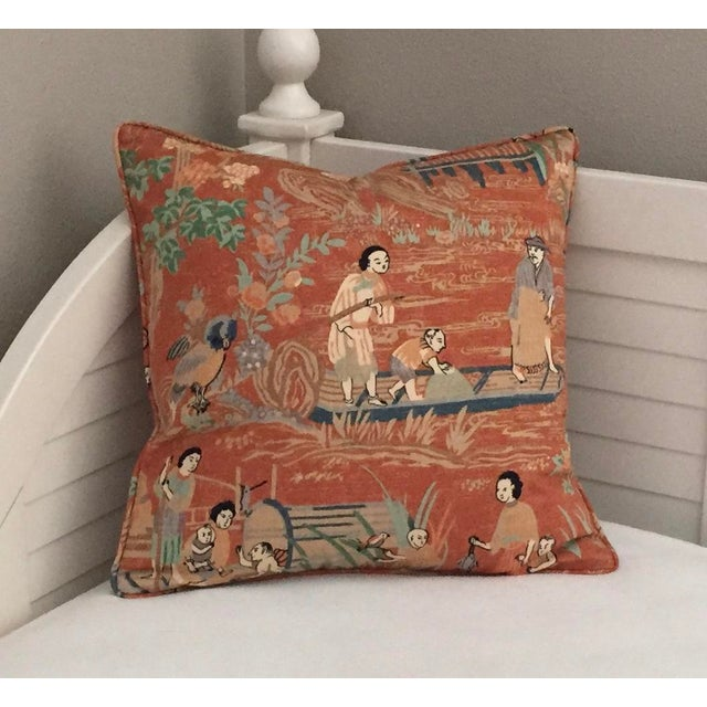 Thibaut Fishing Village in the orange colorway has a rusty shade of orange, blues, gray, taupe, light green, beige, tan...