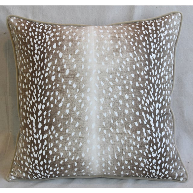 Custom-tailored pillow in a printed linen fabric depicting an antelope, deer/fawn animal spot design. Complementary cream-...