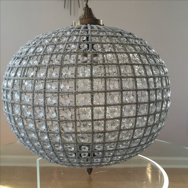 Gorgeous crystal sphere chandelier perfect for the design enthusiast. Classic and goes with any decor. The canopy and...