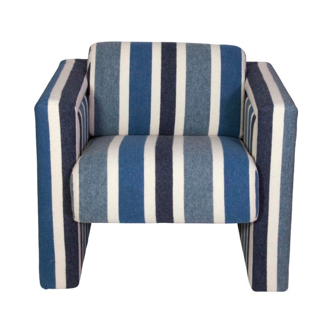 A pair of nautical club chairs in blue and white wool upholstery. A pretty and cool pair that is masculine yet modern.