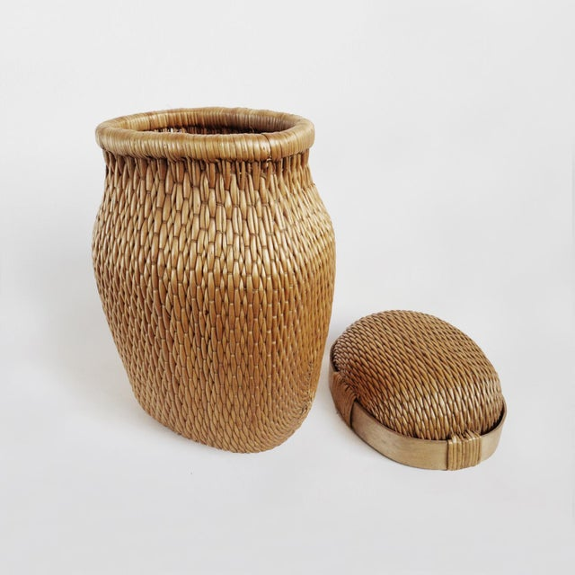 Vintage Chinese fish basket weaved from natural willow material. Wonderful display piece with removable lid.