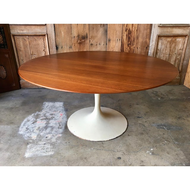 Walnut topped dining table with beveled edge and off white metal base. Made in the mid 20th century.