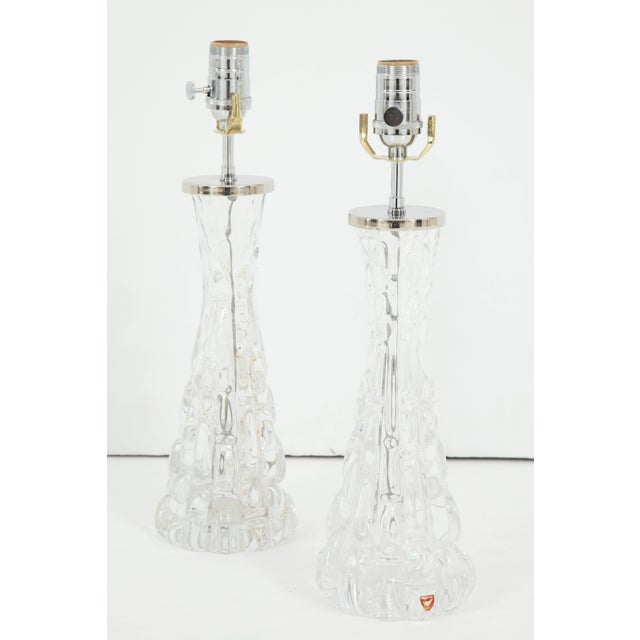 These stunning clear lamps have a sculptural quality about them. Created by Orrefors Crystal, the lamps have an hourglass...