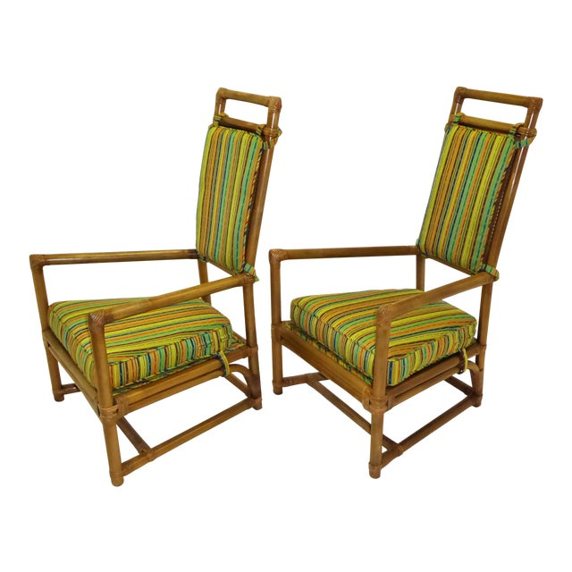 From the Pavilion collection for Willow and Reed, Inc., a pair of Tommi Parzinger armchairs. A 1950s design in rattan and...