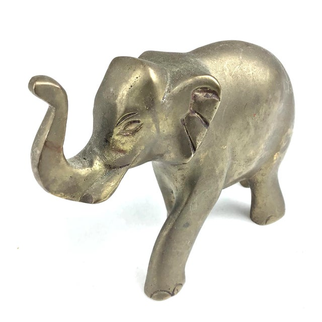 Adorable little elephant with his lucky trunk up. Details are very cute and his form is perfect.