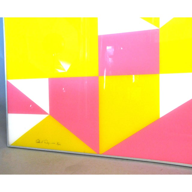 An engaging frame modern artwork, with painted geometric forms in white, pink, and yellow. The piece framed in aluminum,...